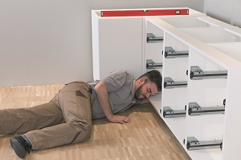 picture of someone installing cabinets traditionally